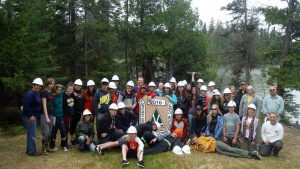 Dryden conservation camp participants pose near lake