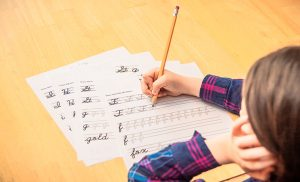 a child practicing cursive